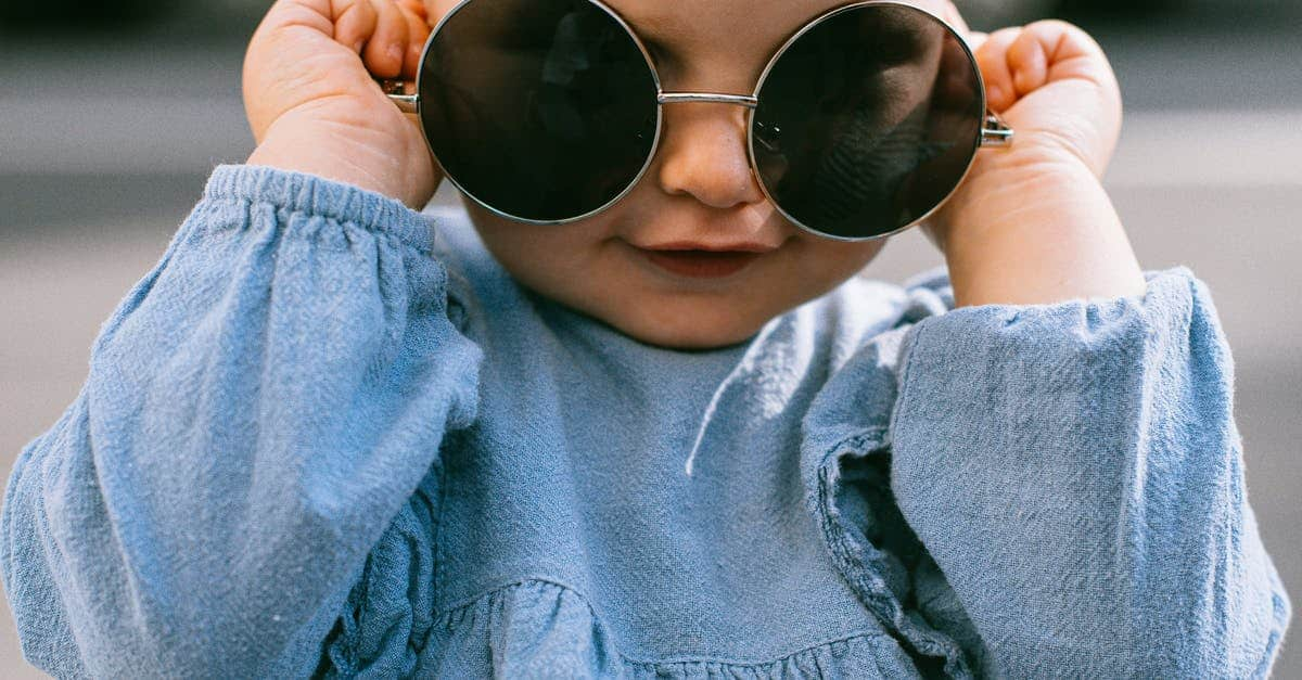 A close up of a boy wearing sunglasses