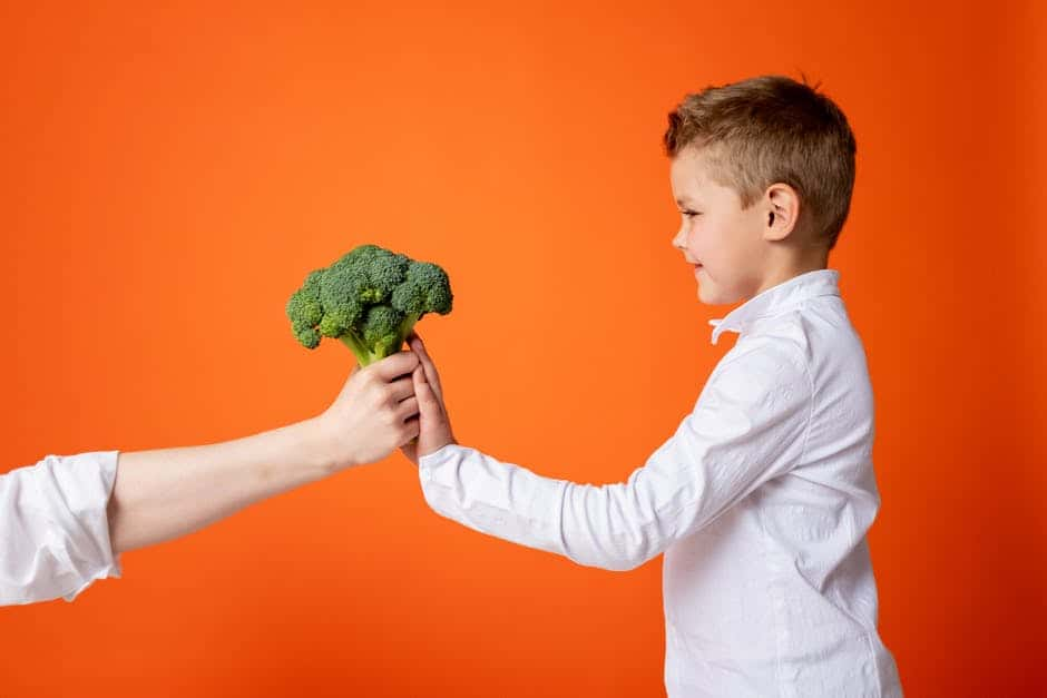 Boy Holding a vegetable