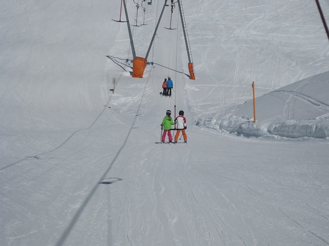 A group of people riding skis across snow covered ground