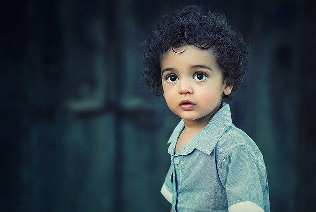 A little boy wearing a green shirt