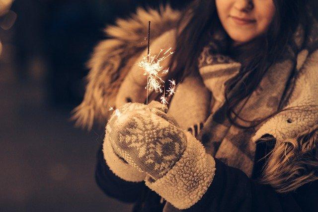 A woman holding a teddy bear