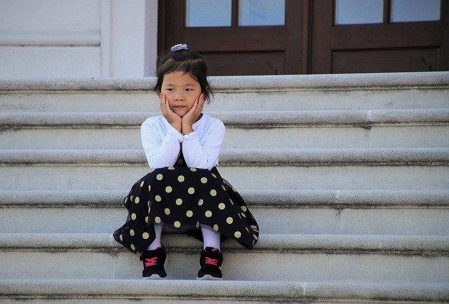 A girl sitting on a ledge